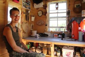 Murphy Robinson sits in the kitchen of her tiny home on wheels. Courtesy Murphy Robinson.