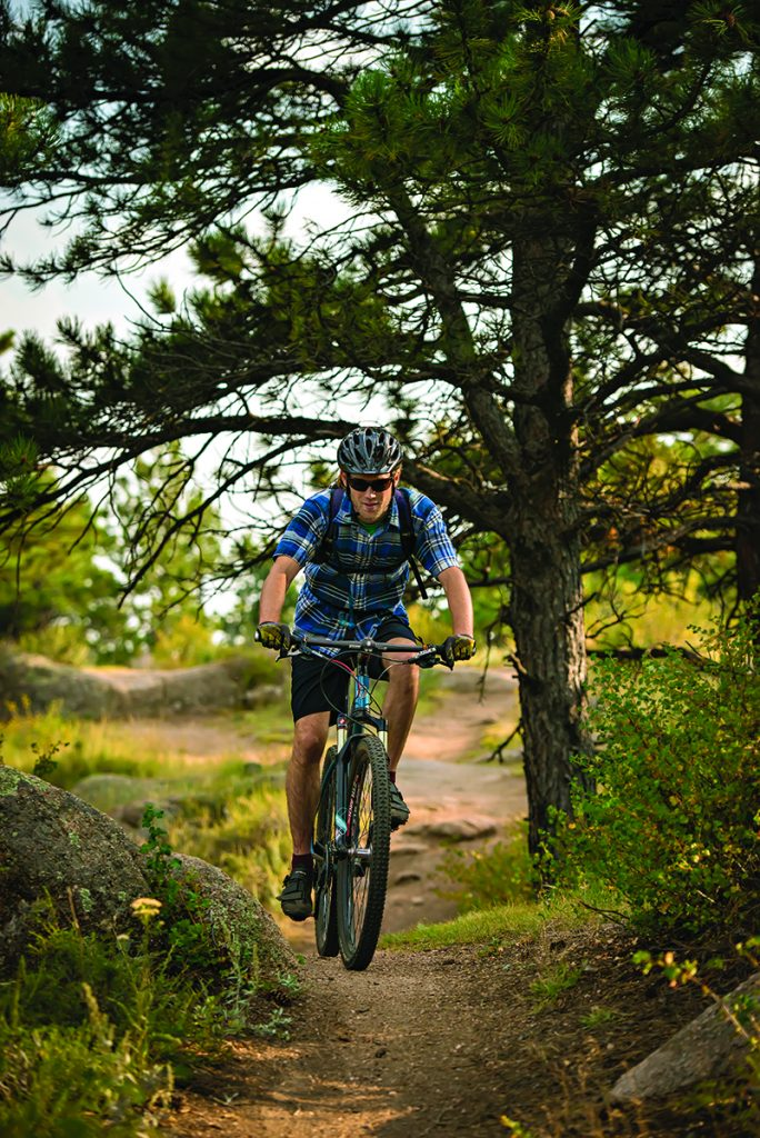 UW Graduate Student Michael Hague mountain bikes at Curt Gowdy State Park along the Stone Temple Circuit Trail. Michael, from Lilburn, Ga., is in the Zoological and Physiological studies.