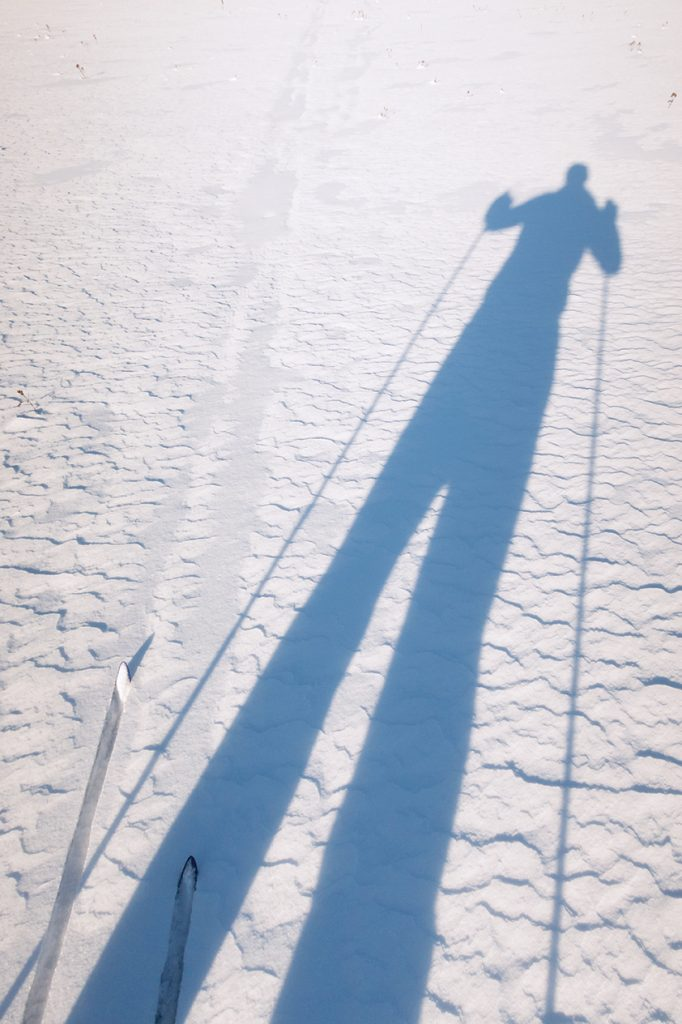 skier shadow on snow