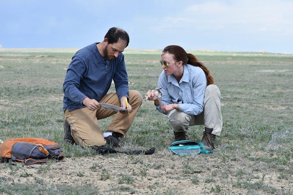 Courtney Duchardt and David Augustine in field
