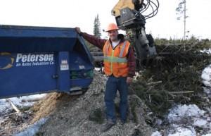 Morgan Larimore takes a break from operating a skidder at the WRR worksite.