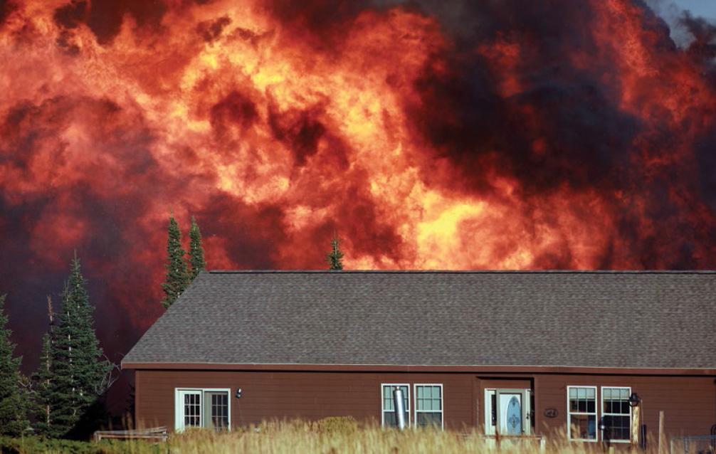 Casper Star-Tribune photographer Alan Rogers during the 2012 Sheep Herder Hill fire