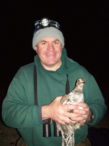 Scientist Jeff Beck with a sage grouse captured as part of a habitat study. Photo courtesy Jeff Beck.