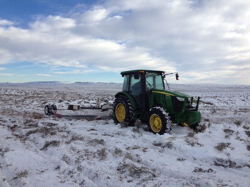 A tractor mows sagebrush as part of a long-term habitat study near Jeffrey City, Wyoming. Photo courtesy Jason Carlisle.