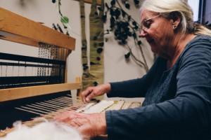 Doris Florig weaving in her studio at the Teton Science Schools Kelly Campus. Photo by Mac Staryk.