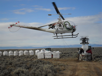 Helicopters distribute pelleted urea to fertilize sagebrush on the margins of the Pinedale Anticline Project Area in western Wyoming. Photo courtesy Dan Stroud.