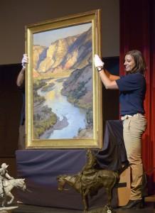 A Clyde Aspevig oil painting on the auction block at the Jackson Hole Art Auction.