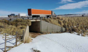 truck driving over underpass